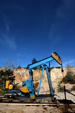 sucker rod pump: An oil rig under bright blue sky Editorial