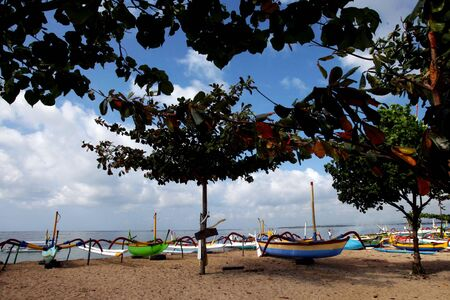 sanur: Traditional colourful fisherman boat in the beautiful Sanur beach, Bali