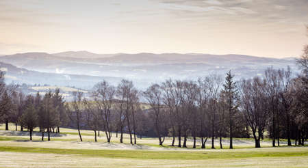 Winter view of golf course with hills in the distance. Werneth Low Country Park on the borders of Stockport and Tameside, Greater Manchester, UK.