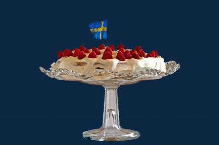 gateau: A typical summer cake or gateau in Sweden with fresh raspberry, double cream on a sponge-cake Stock Photo
