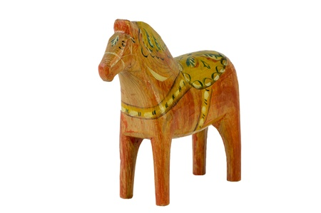 This old and charming Dala Horse  Dalecarlian Horse  has nearly the same form as the modern ones  Originally a toy for children and now a national symbol of Sweden  Isolated on white background  photo