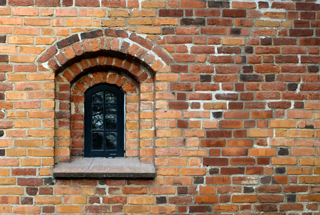 A beautiful round arch window in the old brick wall photo