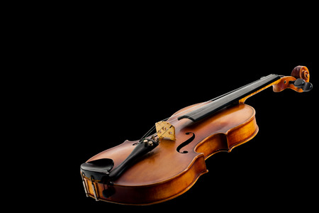 A Still life with a lying fiddle, isolated on black Stock Photo