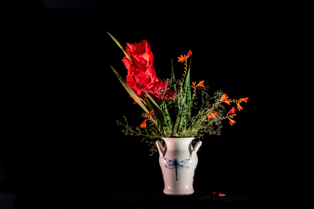 lucifer: A lovely bouquet in red with gladiolus, montbretia Lucifer  and babys breath in a dragonfly pottery.