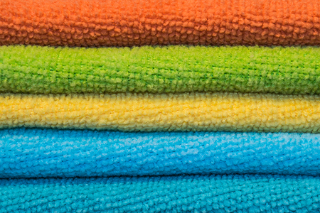 Micro fiber clothes five color red green yellow blue and sky blue Stock Photo