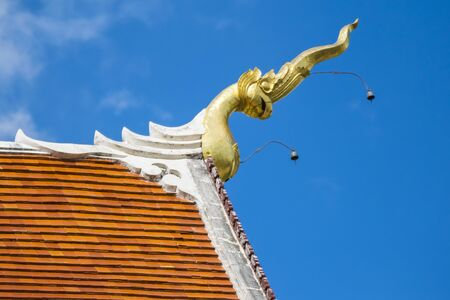 Head of bird on the roof top of temple