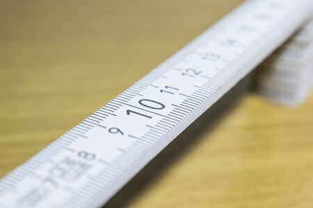 number ten: Scale number ten on wooden white ruler Stock Photo