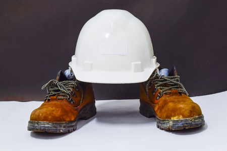 White safety helmet and safety shoes. This is Personal protective equipment for construction work.