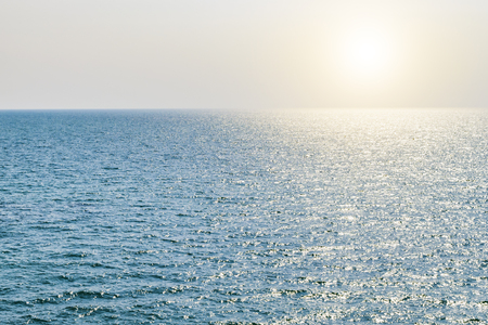 Blue sea texture with sunlight reflection