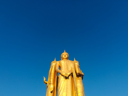 Golden Buddha image stand with clear blue sky