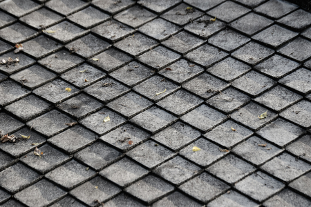 Gray concrete or ceramic tile on the roof of the building