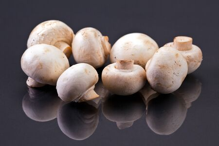 A bunch of button mushrooms. photo