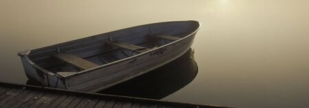 Small Boat at Sunrise Stock Photo
