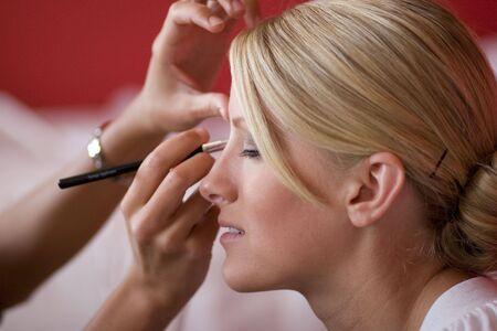eyeliner: Applying Makeup Stock Photo