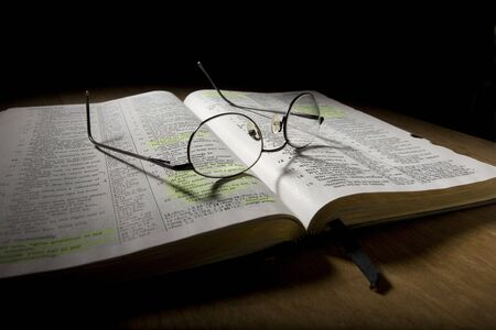 Bible with Eyeglasses photo