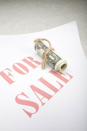 Tied Dollar and For Sale Sign Stock Photo