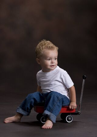 Toddler Boy in Red Wagon photo