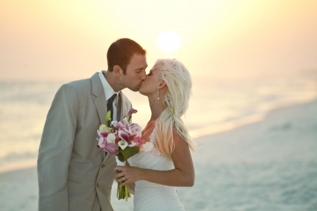 beach kiss: Bride and Groom