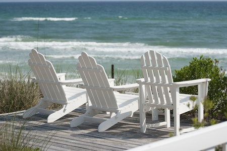 adirondack chair: Deck Chairs at the Beach Stock Photo
