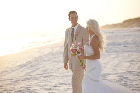 groom and bride: Bride and Groom Walking on the Beach