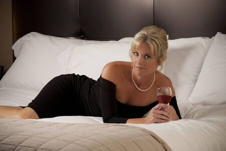 hotel bedroom: Woman Relaxing on a Hotel Room Bed