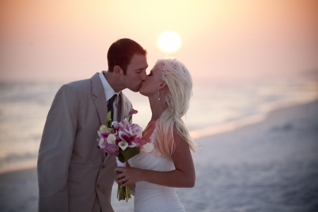 Bride and Groom at Sunset Stock Photo