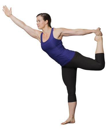 De jonge vrouw in yoga stelt