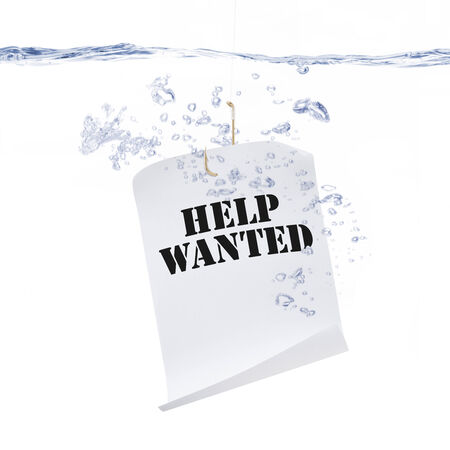 Fish Hook with a Help Wanted Sign Under Water