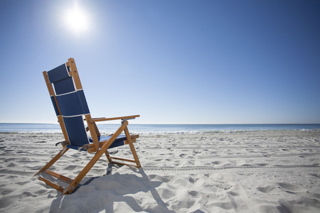 tropical island: Beach Chair in the Sand at the Ocean Stock Photo
