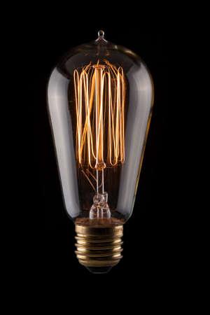 Vintage Lightbulb on Black Background