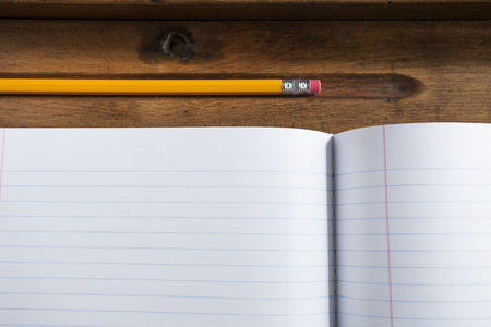 school notebook paper and pencil on wood desk Stockfoto