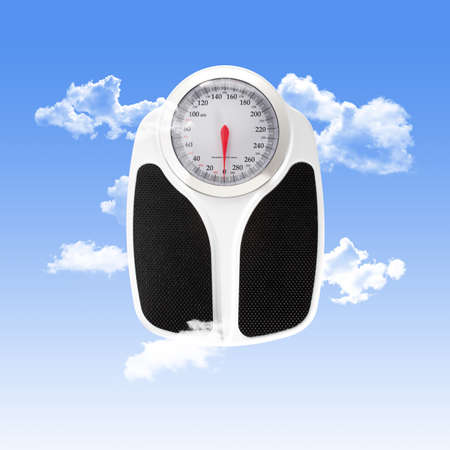 Scale Used for Personal Weight Measuring with Clouds on a Blue Sky Background