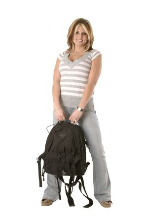 Pretty college aged girl carrying backpack Imagens