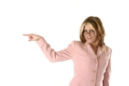 female salesperson, pointing to the left and smiling.