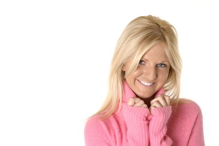 Pretty blonde woman smiling , while wearing a fuzzy pink sweater