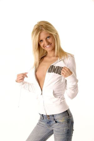 Sexy girl teasing by pulling on the strings of her hoodie, with it partial unzipped and no shirt underneath