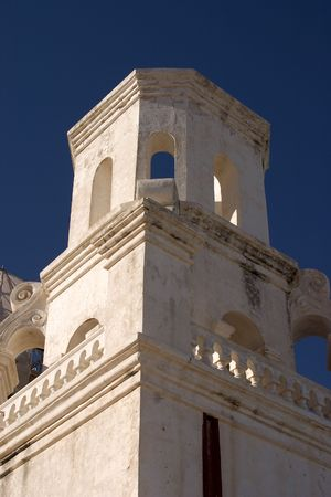 Tower of San Javier del Bac mission outside of Tucson, Arizona. The white dove of the desert.