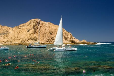 Tropical Mexican Cove with Sailboats and people snorkeling photo