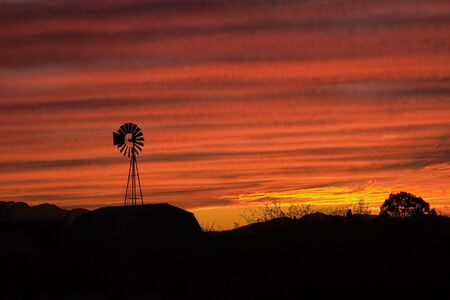 arizona sunset: Lone Windmill silohuetted in an Arizona sunset