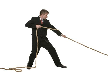 Concept of businessman pulling on rope Imagens