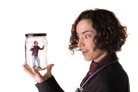 Female Scientist studying monder man Imagens