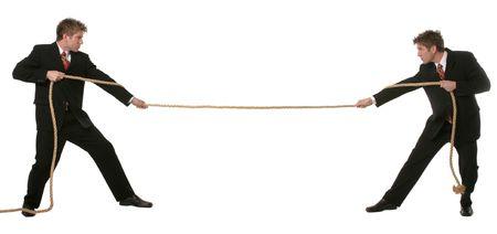 Business Konzept Mann spielen Tauziehen mit sich.  Standard-Bild