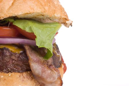 all american burger: Big Bacon Cheeseburger with lettuce, red onion and tomato on a sesame seed bun; with copy space to the right. Stock Photo