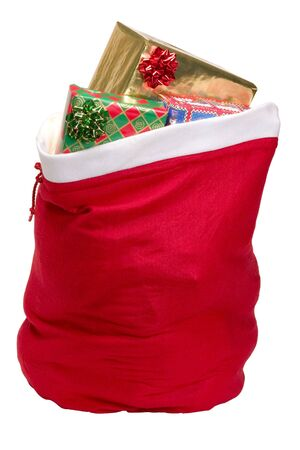 Santas sack filled with presents, with clipping path Imagens