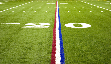 American Pro Football field on the 20 yard line with red white and blue stripe