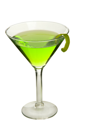 twist: Appletini cocktail drink with apple twist on white high angle. Stock Photo