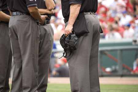 umpire crew meets before the game at home plate Stock Photo - 1456046