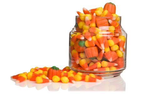 Halloween candy-corn and pumpkins overflowing the jar Stok Fotoğraf