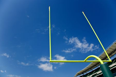 uprights: Football goal posts in the autumn sun and sky