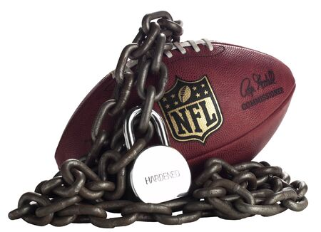 Indianapolis, USA March 4, 2011 - NFL Football with chains and lock around football for the 2011 NFL Lockout